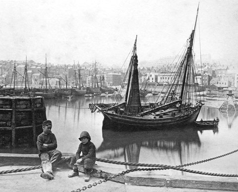 Historic photo of working boys on Scarborough Harbour