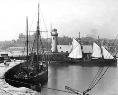 Historical photos of boats and Scarborough harbour