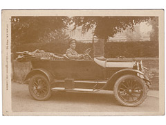 Military driver in car postcard