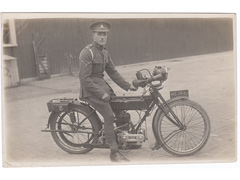 Royal Artillery coporal on Triumph Motorbike postcard