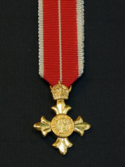 Miniature OBE military medal