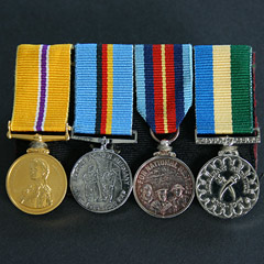 Group of 4 Mounted Miniature Unofficial Medals