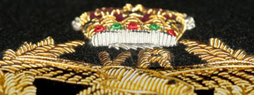Close up detail of a wire blazer badge